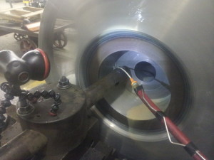 """Boring to true it to the shaft and give a .001"""" press fit"""