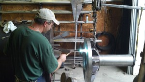 Heating up the whole piece to expand the hole .