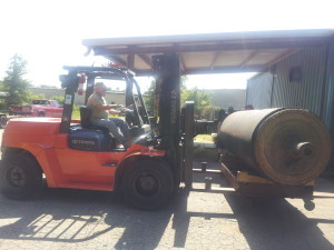 A friends 15,000 lb forklift loading it up.