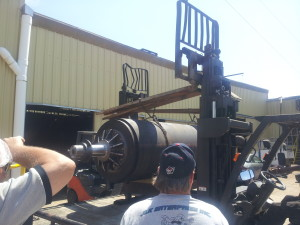 At the customer's plant unloading it with their two 5,000 lb forklifts.